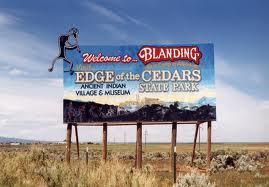 Billboard upon entering Blanding, Utah: both Indians and artifacts